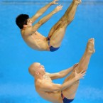 Great Britain's Nick Robinson Baker (bottom) and Christopher Mears in the Men's Synchronised 3m Springboard Preliminary during the 18th FINA Visa Diving World Cup at the Aquatics Centre in the Olympic Park, London. (PA)