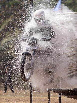 An Indian Army soldier displays his daredevil motorcycle skills during an army fair in Bhubaneshwar, India today.