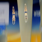 Germany's Patrick Hausding and Sascha Klein in their Men's Synchronised 10m Platform Preliminary during the 18th FINA Visa Diving World Cup at the Aquatics Centre in the Olympic Park, London. Pic: Owen Humphreys/PA Wire/Press Association Images