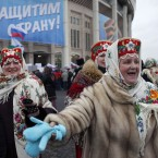 Women dressed in Russian folk costumes dance in front of Luzhniki stadium prior to a massive rally in support of Russian Prime Minister Vladimir Putin in Moscow, Russia. (AP Photo/Alexander Zemlianichenko)