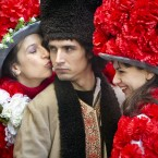 A man wearing a traditional Romanian outfit receives a kiss from a girl wearing a floral outfit, in Bucharest, Romania, Friday, Feb. 24, 2012, during celebrations of the Dragobete, the day of lovers.(AP Photo/Vadim Ghirda)
