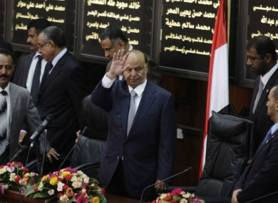 Yemen's newly elected President Abed Rabbu Mansour Hadi waves as he arrives to the Parliament in Sanaa earlier today
