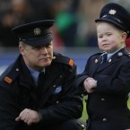 Inspector John Ferris chats with Dylan Steele, aged seven, who won a competition to be a Garda for the day, during the RBS Six Nations match between Ireland and Italy at the Aviva Stadium, in Dublin. Pic: PA images