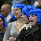 Fans with bright blue wigs in the stands during the Manchester City v Blackburn Rovers match.