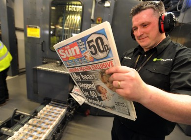 A printer reads one of the first copies of the Sun on Sunday hot off the press last night.