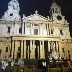 A policeman stands on duty outside St Paul's cathedral while Corporation of London workers clean the Square in front of St Paul's after police removed protesters camped in the square. Photo: Max Nash/PA Wire