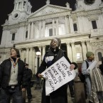 Occupy London protesters stands outside St Paul's Cathedral in London after bailiffs moved in to remove tents from the anti-capitalist Occupy London camp. Photo: AP Photo/Sang Tan