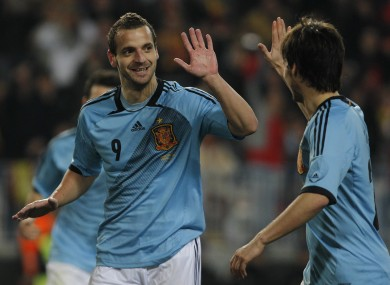 Soldado celebrates his hat-trick with David Silva.