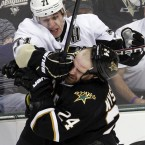 Pittsburgh Penguins center Evgeni Malkin (71) hits Dallas Stars left wing Eric Nystrom (24) during the third period of an NHL hockey game in Dallas, Wednesday, Feb. 29, 2012. (AP Photo/LM Otero)