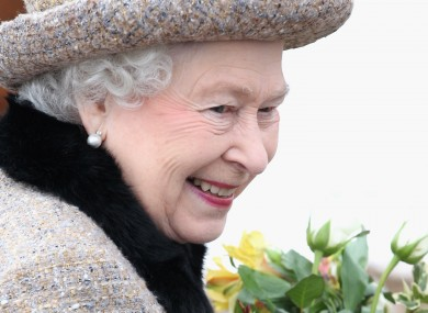 Queen Elizabeth smiles after attending Sunday service at a church in Norfolk yesterday.