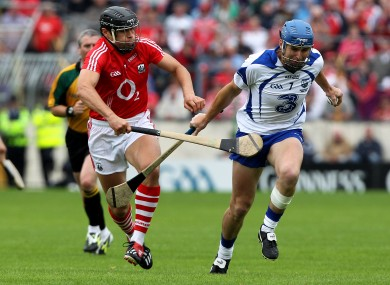 Cork's Sean Og O hAilpin and Derek Prendergast of Waterford.