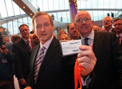Enda Kenny picks up his delegate pass yesterday evening.