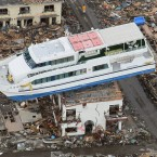 A passenger ship left on top of a building in Otsuchi, Iwate Prefecture by the tsunami. (Kyodo/PA Images)