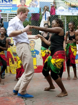 Prince Harry dancing in his blue suede shoes with Chantol Dorner in Jamaica.