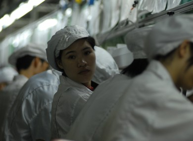 Employees at a Foxconn factory in Shenzhen in 2010