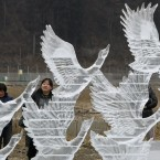 People admire Ice craft for reqiem of Tsunami victims in the earthquake and tsunami-devastated city of Rikuzentakata, Iwate prefecture, northeastern Japan. (AP Photo/Koji Sasahara)