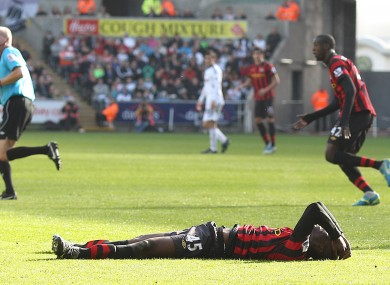 Down and... out? Mario Balotelli lies forlorn