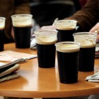 Race goers check form over a pint of Guinness 