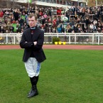 Jockey Denis O'Reagan waits in the parade ring before racing  on the opening day of the Festival.