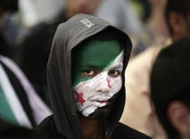 A Yemeni boy attends a ceremony making the anniversary of the Syrian revolution in Sanaa, Yemen.