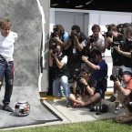 Photographers wait for Red Bull driver Sebastian Vettel as he prepares for a photo shoot ahead of the Australian Grand Prix.