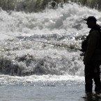 Chris Melohusky fishes for steelhead in Buffalo Creek in Elma, New York. (AP Photo/David Duprey)