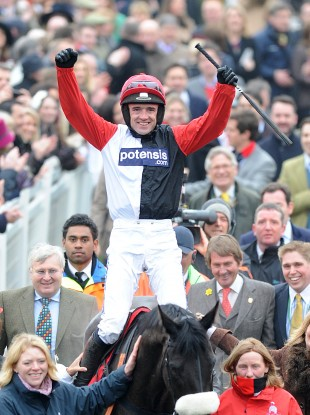 Jockey Ruby Walsh celebrates winning the Ladbrokes World Hurdle on Big Buck's.
