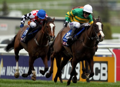 Tony McCoy on Synchronised as they go on to win the Betfred Cheltenham Gold Cup Steeple Chase.