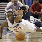 Philadelphia 76ers' Jodie Meeks dives for a loose ball against the Miami Heat.