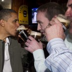 President Barack Obama drinks a Guinness with his ancestral cousin from Moneygall Henry Healy, centre, and the owner of the pub in Moneygall, Ollie Hayes, right, at The Dubliner Restaurant and Pub and Restaurant on St. Patrick's Day, in Washington. (AP Photo/Carolyn Kaster)