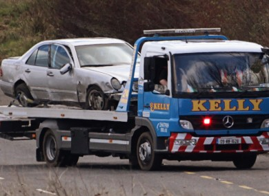 The off-duty Garda's car being taken from the scene earlier today.