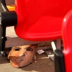 Face off: A discarded Paolo Di Canio mask lies in the stands after Swindon's 2-0 defeat against Chesterfield in the Johnstone Paint Trophy.