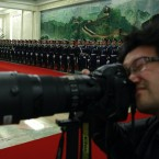 A photographer uses his camera near a Guard of Honor contingent during the welcome ceremony at the Great Hall of the People in Beijing, China today (AP Photo/Ng Han Guan)