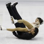 Mind the ice: Yuko Kavaguti and Alexander Smirnov of Russia lose their balance and fall as they perform during their Pairs Short program at the ISU 2012 World Figure Skating Championships.