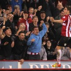 Get in: Sheffield United's Ched Evans celebrates in front of the home support after scoring a hat-trick against Chesterfield.