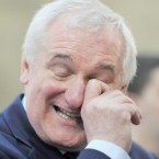 Bertie Ahern has a laugh at the RDS yesterday. Photo: Laura Hutton/Photocall Ireland