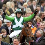Jockey Noel Fehily celebrates a win with Rock On Ruby in the Stan James Champion Hurdle Challenge Trophy.
