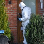 Garda forensic photographer takes a photograph of a blood-stained towel at the scene of a double murder in the Rochford estate in Kilcock, Co Kildare. Pic: Laura Hutton/Photocall Ireland