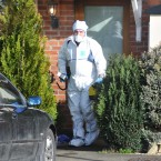 A Garda forensic photographer at the scene. Pic: Laura Hutton/Photocall Ireland