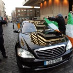 Pictured protesters drape the tri-colour over what looked to be bank cars. Photo: Sam Boal/Photocall Ireland.
