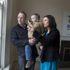 Parents Keith Greene and Jennifer Clail point out some features of their new neighbourhood to their son Nathan from the window of their new home in Inchicore, Dublin. 