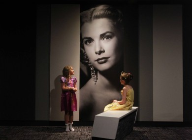 Amy Russell (8) and Abbey Goldings (6) look at a picture of Grace Kelly at the IMC Tallaght