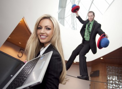 Rosanna Davidson pictured with tightrope walker Paul Quate at the launch of Microsoft's Work from Wherever Wednesday