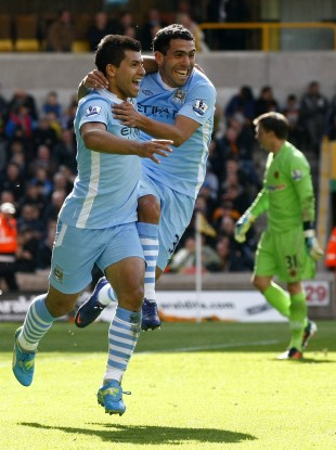 Aguero and Tevez celebrate the opener.