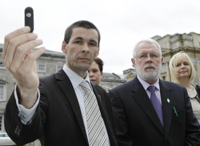 Sinn Féin's Jonathan O'Brien, on 5 April 2011, holds memory stick which was said to contain the audio of gardai joking about rape and deportation in relation to Corrib protestors.