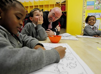 Education Minister Ruair Quinn with school children in Dublin yesterday.