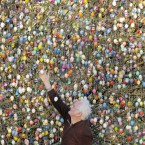 Volker Kraft decorates a tree with 10,000 Easter eggs in his garden in Saalfeld, Germany, Wednesday, March 21, 2012. The Kraft family has been decorating their tree for Easter for more than forty years. (AP Photo/Jens Meyer)