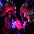 Performers in their lighted costumes after the symbolic switching off of lights in observance of Earth Hour. (AP Photo/Pat Roque)