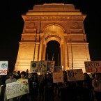 Indians hold placards and participate in a rally to mark Earth Hour in front of the landmark India Gate in New Delhi, India. (AP Photo/Mustafa Quraishi)