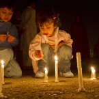 Children light candles during a ceremony to mark Earth Hour in Islamabad, Pakistan. (AP Photo/Anjum Naveed)